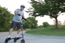 Timothy Johnson rides a Trikke