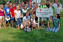 Jim Zaffiro with students in the organic garden