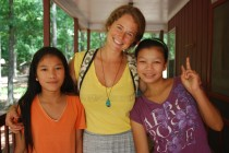 Sara Crippen '11 helps care for refugee children Htay Htay Aung and Cho Thin at Jubilee Farms in Georgia.