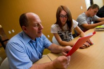 Mitch Lutch works with a student during his fall 2011 Intersections course.