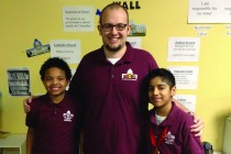 "Justin Tiarks '06 tells his students that he will be at St. Paul City School until he is ""old and gray."""