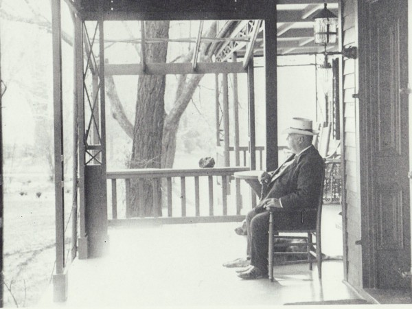 The railroad magnate Charles E. Perkins on the porch of the Apple Trees building when it was his home.