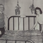 Roommates Alice Terpstra La Rosa '44and Jane Van Kempen making their bed in Graham Hall.