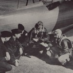 Ray Doorenbos and Marvin Baker were  ground instructors and Earl Pohlmann (second from right) was a flight instructor for the Navy cadets.