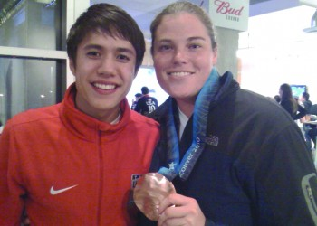 Sarah Newman '01 (right) with JR Celski, U.S. Short Track Speedskating Olympian, at the 2010 Vancouver Olympics.