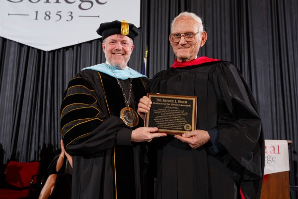President Mark Putnam and Arthur Bosch '51 at the 2013 commencement ceremony