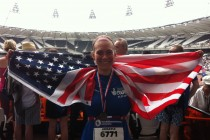 Abby Norman '12 moved to London after graduation and received her master's degree. In her free time, she trains for triathlons. Abby is pictured after the Olympic Park five-mile race with an American flag her English friends purchased for her.