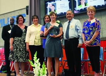 Melissa Urbain '05 accepts her Teacher of the Year
