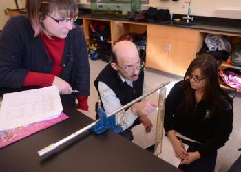 Viktor Martisovitz, associate professor of physics, explains the principles of physics laws.