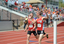 Senior Drew Jackson celebrates crossing the finish line with senior Timothy Shepherd as Shepherd takes the Iowa Conference title in the 3,000-meter steeplechase.