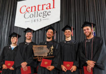 5 senior members of the Men's Track squad pose at graduation with their 2016 Iowa Conference championship trophy.