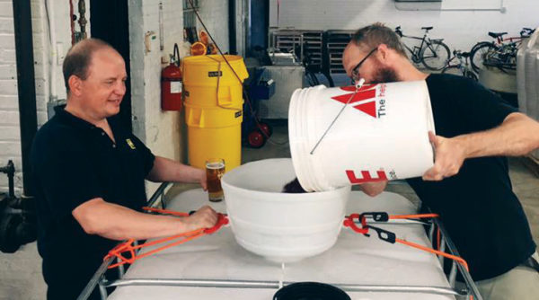 Bill Wesselink '98 (right) and his business partner, Hagen Dost, focus on brewing European-style ales and lagers.