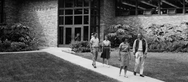 Students walk near the former library (now Lubbers Center for Visual Arts) in the early 1960s.