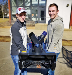 Challen and McCleary carry the Ankle Biter outside before demonstrating it to Central's senior leadership team.