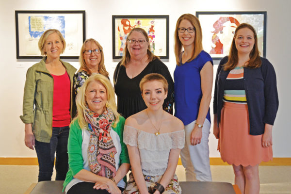 From left to right, front row to back row: Lynn Hinga Branderhorst '79, Callie Gardeman '18, Ann Hinga Klein '80, Professor of Chemistry Cathy Hinga Haustein '76, Professor of Art Treva Reimer, Michelle Stam and Sarah Purdy '16.