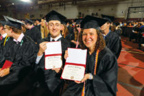 Hunter Caspers '18 and Jessie Cassens '18 showing off their diplomas