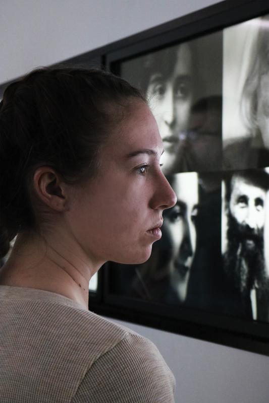 Cheyanna Jennings '20 views photographs of Holocaust victims at the Auschvitz Jewish Center, Oświęcim, Poland.