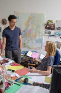 Christian Escobar '20 talks with Vienna program director Ruth Verweijen in her office.