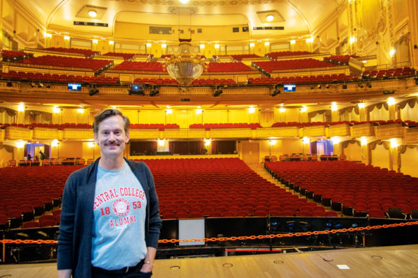 Rob Lindley standing on stage with the empty theater behind him.