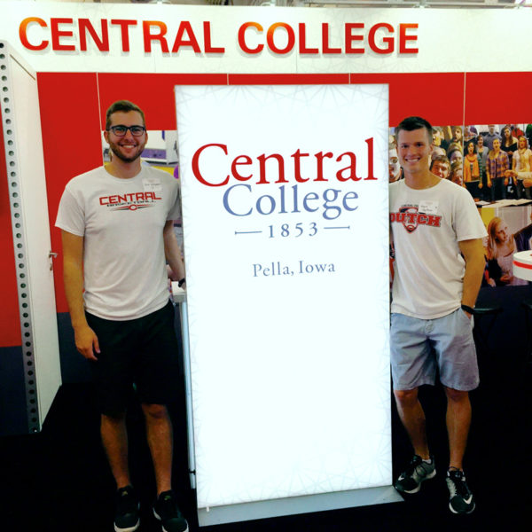 Roommates Rick Williamson '15, left, and Grant Seuferer '14, right, volunteering at the Central booth at the Iowa State Fair.
