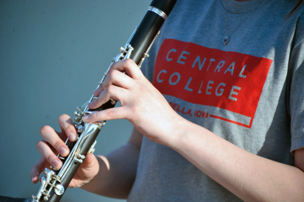 Student playing a clarinet at one of Central's music-focused camps.