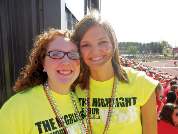 Roommates Alison Redman Westfall '13 and Sarah Rankin Folkerts '13 at a Central College Dutch football game during their student days.
